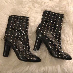 Black shiny leather studded heel boots